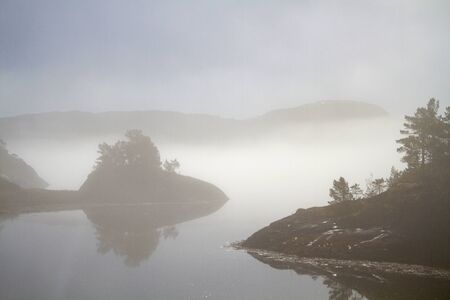 Morning mist on the fjord - the little sea arm Fjaerangen offers a magical sight