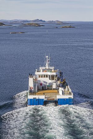 Transport ship passes at a fast pace the Naeroysundet at Rorvik Banco de Imagens