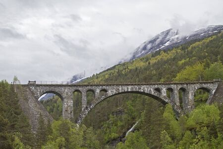 The Kylling Bru is a railway bridge built in the years 1913-1921. It is one of the most famous railway bridges in Norway and at the same time landmark of the Raumabanen.