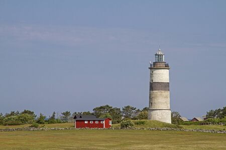 The lighthouse Morups Tange is idyllically situated in a nature reserve on the Swedish North Sea coast Banco de Imagens