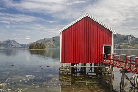 Red boat huts in Sor Eitran idyllically built on piles in the Eiterfjorden