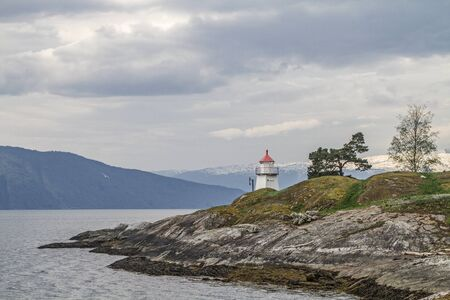 Close to Hermansverk, this idyllic lighthouse stands on the banks of the Sognefjord and gives the ships the right way beacon