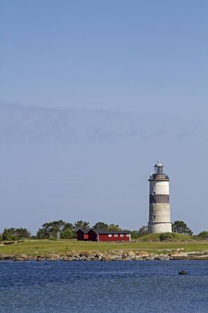The lighthouse Morups Tange is idyllically situated in a nature reserve on the Swedish North Sea coast Standard-Bild