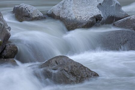 Long exposure on the wild river Ötz in the valley of the same name in Tyrol