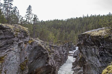 Ritterspranget, also called Rittersprung after an old legend, is a popular natural spectacle in the narrow canyon of the river Sjoa