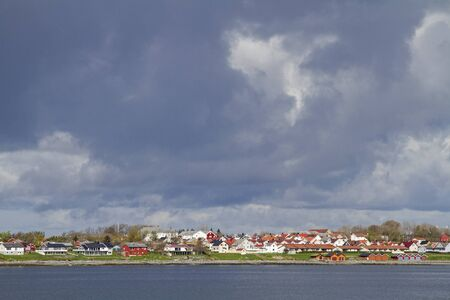 Travel by car ferry from Valset via the Trondheimfjorden to Brekstad, a small Norwegian town on the Trondheimfjorden