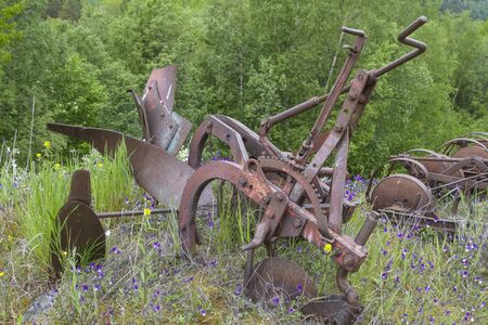 Old rusted plow parked in the wild and forgotten Reklamní fotografie