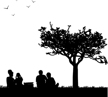 Family picnic in park in spring silhouette