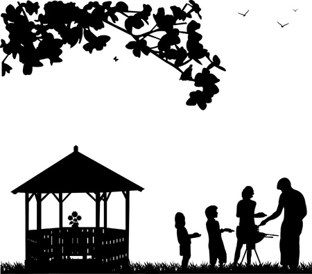 family eating: Family barbecue and picnic in the garden next to the arbor or summer house and butterflies flying under a tree silhouette