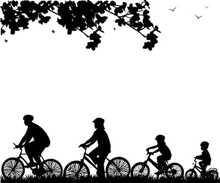 family vacations: Family bike ride in park in spring silhouette