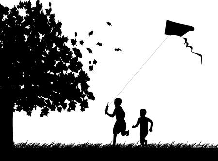 Silueta de funcionamiento chicos con vuelo de cometas en el parque en el otoño o el otoño