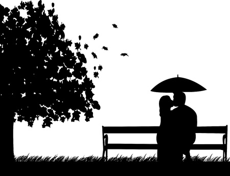 autumn park: Couple sitting on a park bench and kissing under umbrella in autumn or fall silhouette