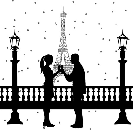 year's eve: New Year s Eve in Paris, a couple toasting with champagne at midnight in front of Eiffel tower silhouette