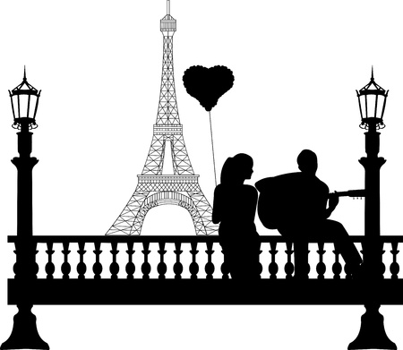 Couple in love on Valentine s Day where a guy plays guitar girl in front of Eiffel tower in Paris silhouette