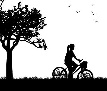 Young woman ride bike in park in spring silhouette, one in the series of similar images