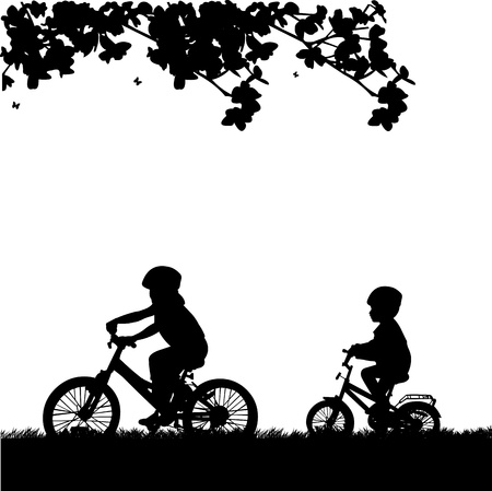Kids bike ride in park in spring silhouette, one in the series of similar images
