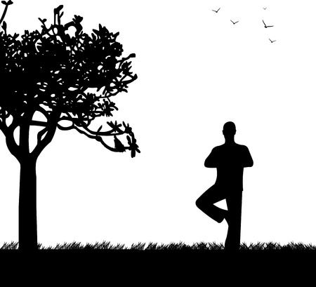 introspection: An isolated man meditating and doing yoga exercise under the tree in park in spring silhouette, one in the series of similar images