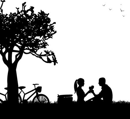 romantic date: Romantic couple in picnic, with bikes in park under the tree toast with glass of wine in spring silhouette, one in the series of similar images