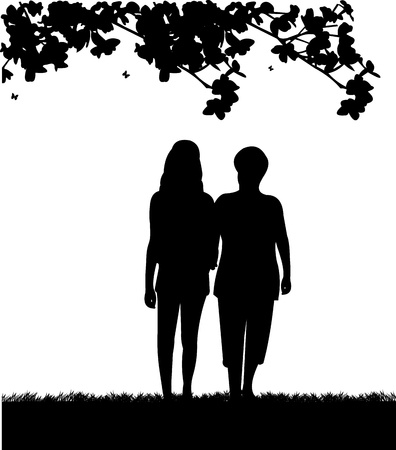 Mother and daughter walking in park, one in the series of similar images silhouette