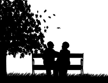 Mooi gepensioneerd paar ouderen zitten op een bankje in het park in de herfst of najaar, een in de reeks van soortgelijke foto's silhouet