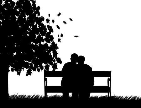 Lovely retired elderly couple sitting on bench in park in autumn or fall, one in the series of similar images silhouette
