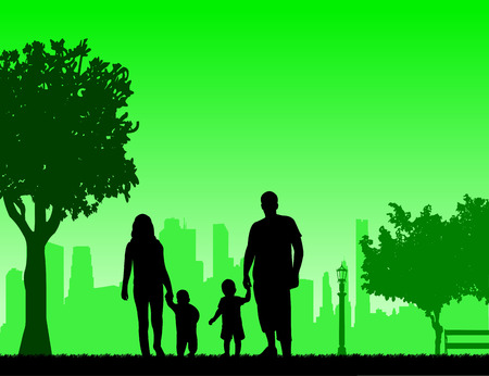 Family walking with their children in park, one in the series of similar images silhouette