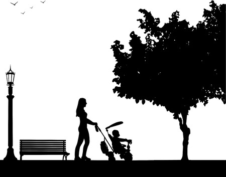 mammy: Mother walking with her baby on a tricycle in park, one in the series of similar images silhouette