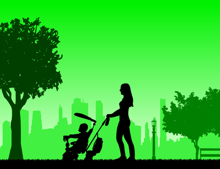 Mother walking with her baby on a tricycle in park, one in the series of similar images silhouette