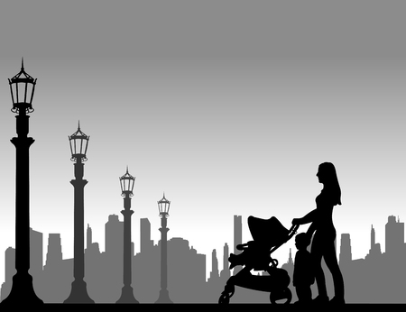 mammy: Mother walking with her children on the street, one in the series of similar images silhouette