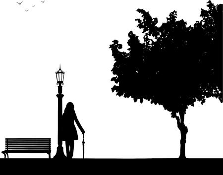 若いセクシーな女の子が立っていると公園と同様のイメージ シルエットのシリーズの 1 つの傘で誰かを待っています。