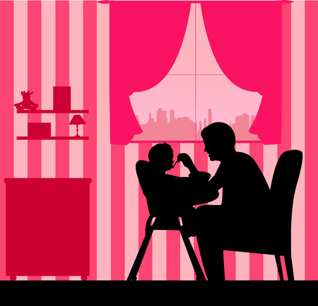 Father nourishes the baby girl silhouette