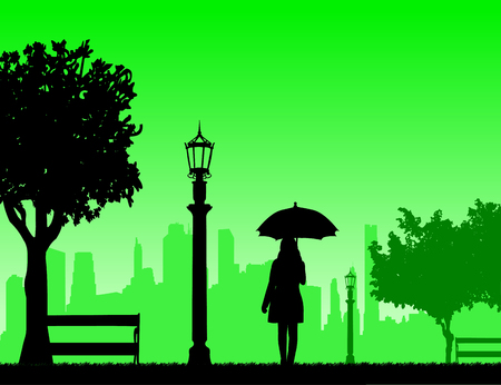 Young woman walking under the umbrella in park in autumn or fall, one in the series of similar images silhouette