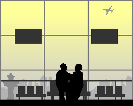 An elderly couple in love is waiting for their flight to the airport