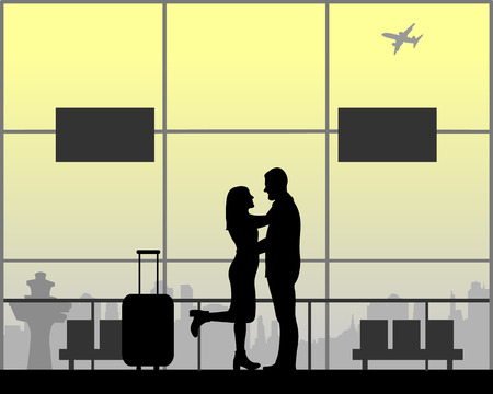 A young in love couple is waiting for their flight to the airport silhouette