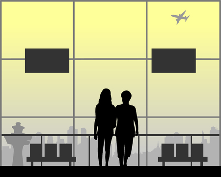 Mom and daughter are walking at the airport while they are waiting for their flight silhouette