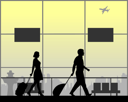 Young couple hurry to their flight, one in the series of similar images silhouette