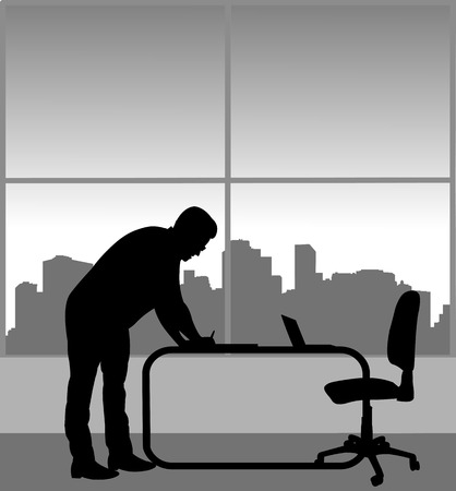 A young business man signs a document in his office, one in the series of similar images silhouette