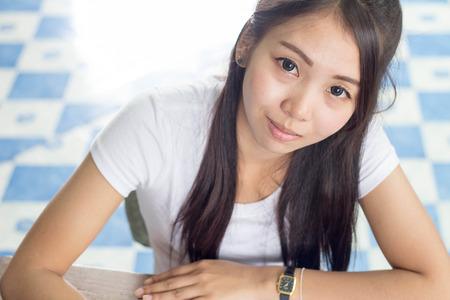 A thai woman wearing white shirt smiling photo