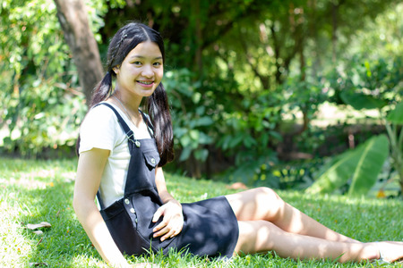 thai student: Portrait of thai student teen beautiful girl Dress black happy and relax On Park Stock Photo