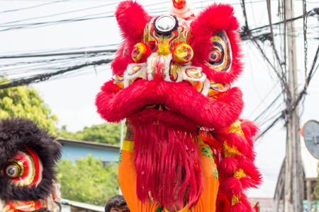 BANGKOK, THAILAND - April 4 2015: Unidentified people of parade Local tradition Thailand, Thai people playing chinese lion dance to celebrate of Songkran Thai new year  water festival