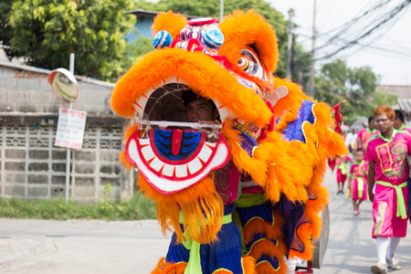 thai people: BANGKOK, THAILAND - April 4 2015: Unidentified people of parade Local tradition Thailand, Thai people playing chinese lion dance to celebrate of Songkran Thai new year  water festival