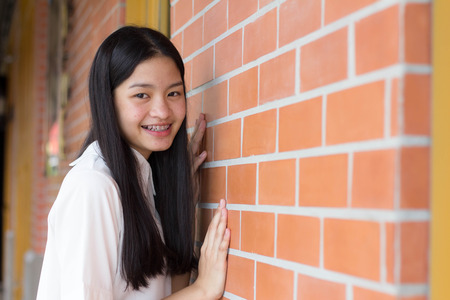 thai student: Portrait of thai student teen beautiful girl relax and smile.