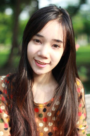thai student: Portrait of thai student teen beautiful girl relax and smile in park.