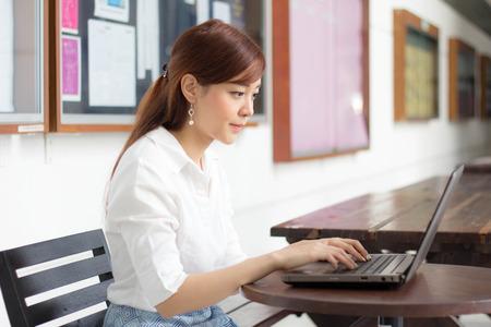 Portrait of thai adult businesswoman beautiful girl using computer notebook.