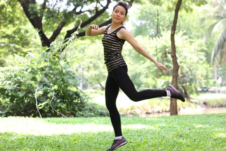 exert: Portrait of thai adult beautiful girl relax and smile in the park