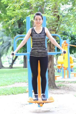 exert: Portrait of thai adult beautiful girl doing exercises in the park
