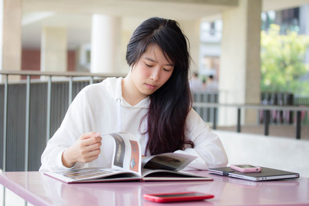 thai student: Portrait of thai student university beautiful girl read a book