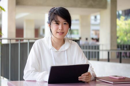 thai student: Portrait of thai student university beautiful girl using her tablet