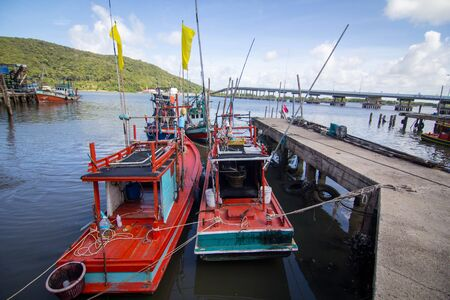 catch fish: Thai fishing boats in the harbor,Waiting to catch fish Stock Photo