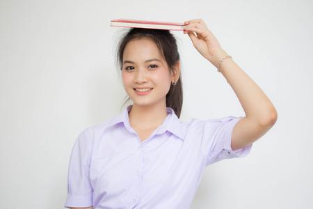 asia thai high school student uniform beautiful girl read a book Zdjęcie Seryjne